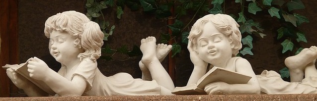 Statues of Kids Reading Books